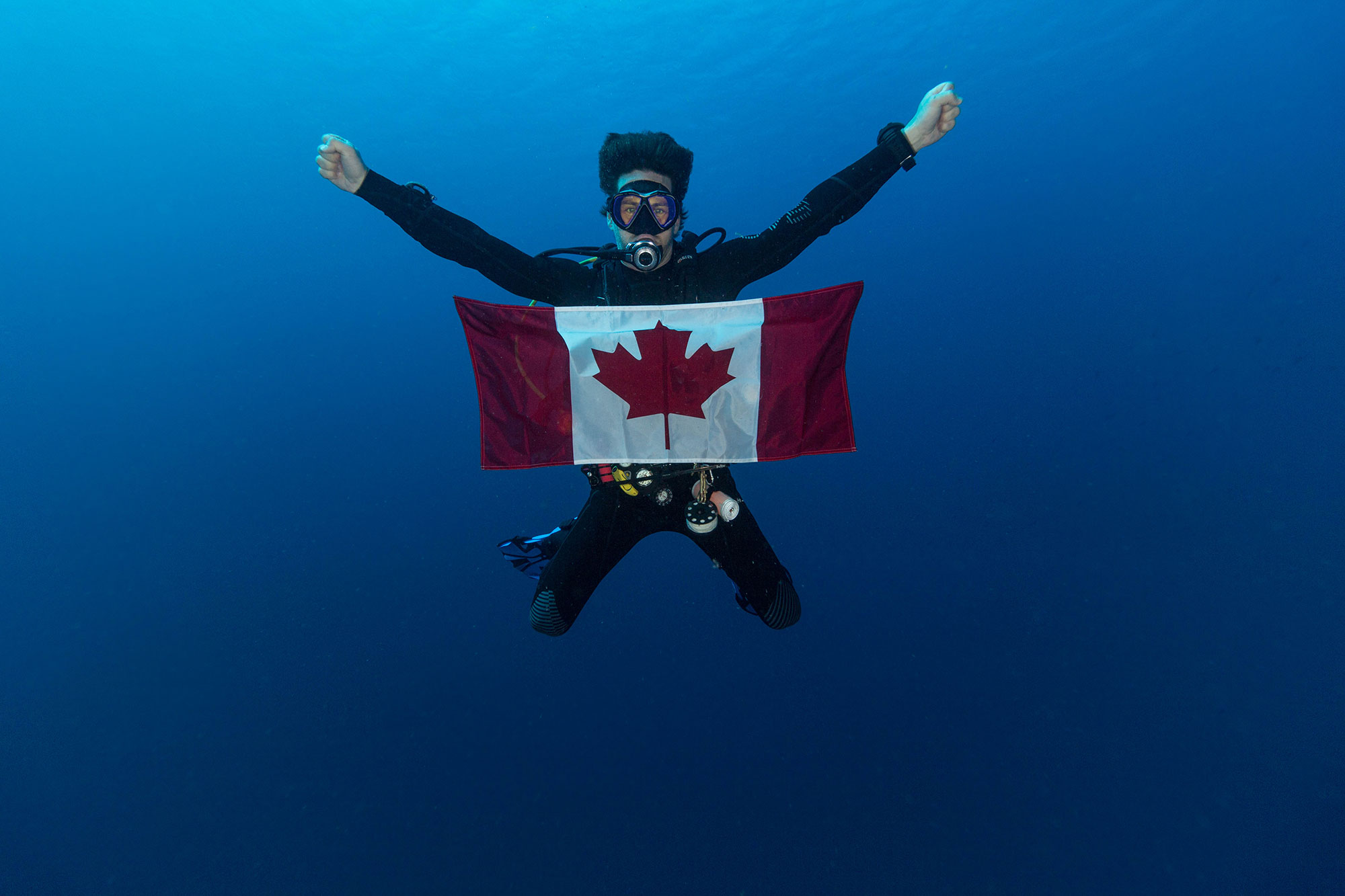 Scuba Joey Underwater with a Canadian Flag
