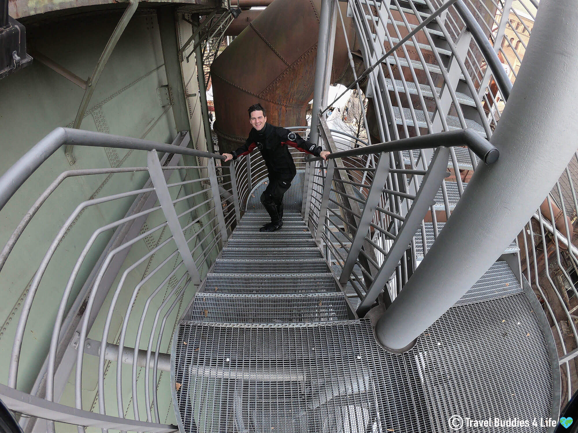 Joey Climbing The Stairs To The Gas O Meter In His Drysuit, Germany, Europe