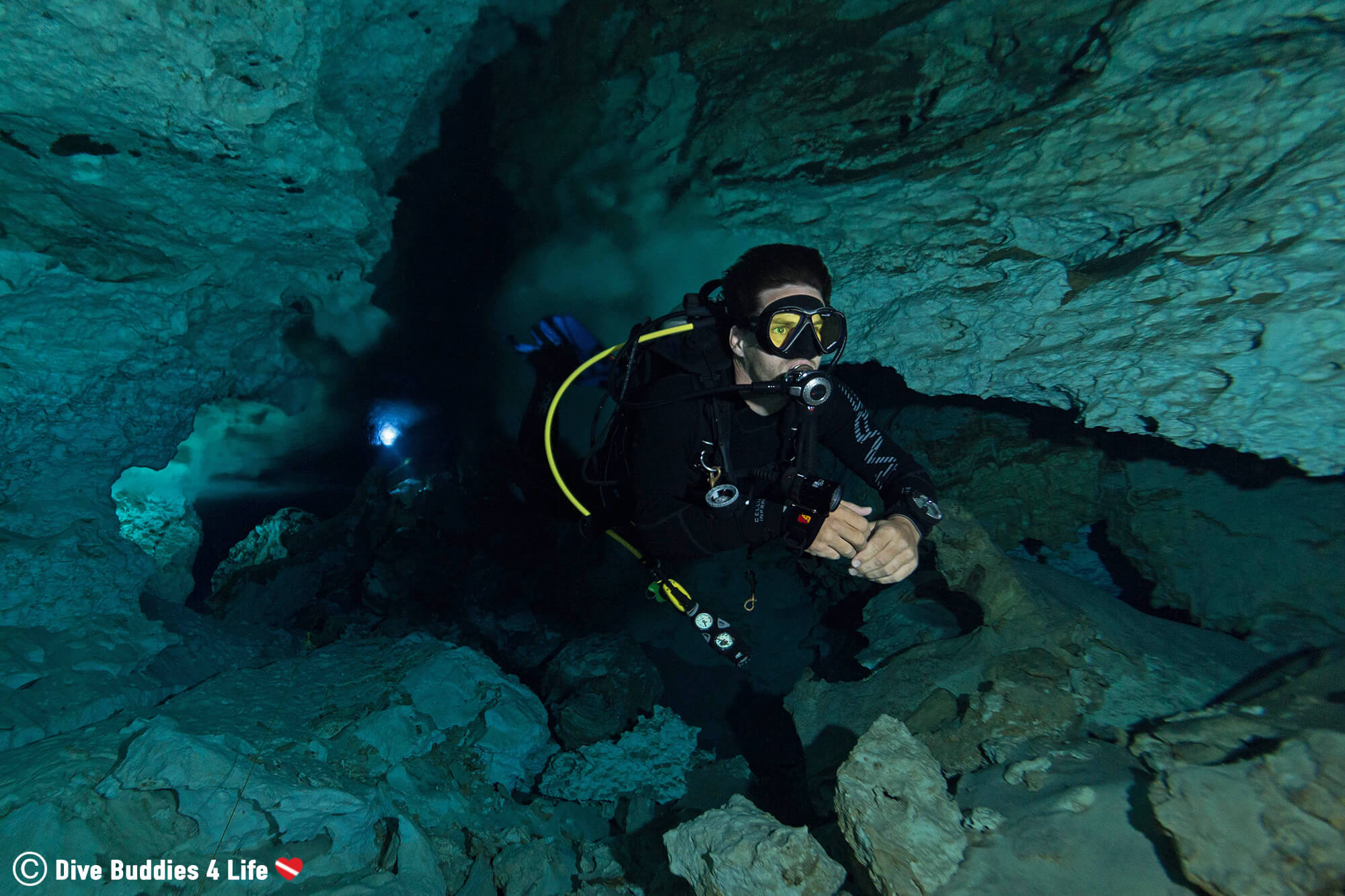 Joey Diving Through The Halocline In The Temple Of Doom Cenote, Tulum, Mexico