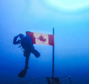 Joey Diving with Canadian Flag