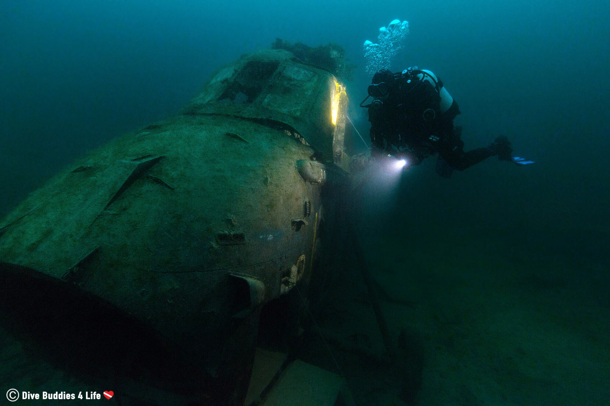 Joey Diving With A Sunken Helicopter In The Chepstow Quarry In Whales, UK, Europe