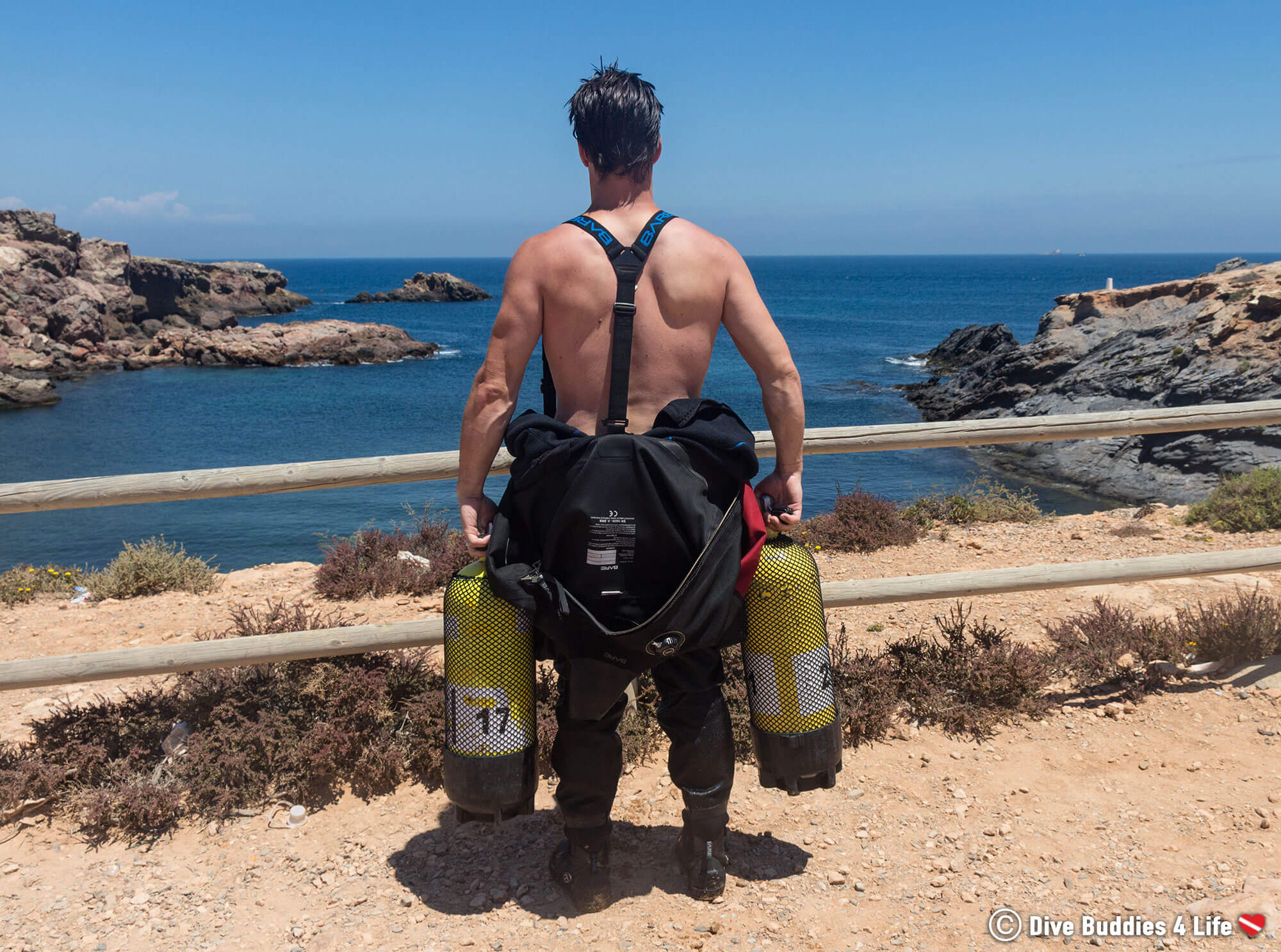 Joey Gazing Off Into The Horizon With Scuba Tanks