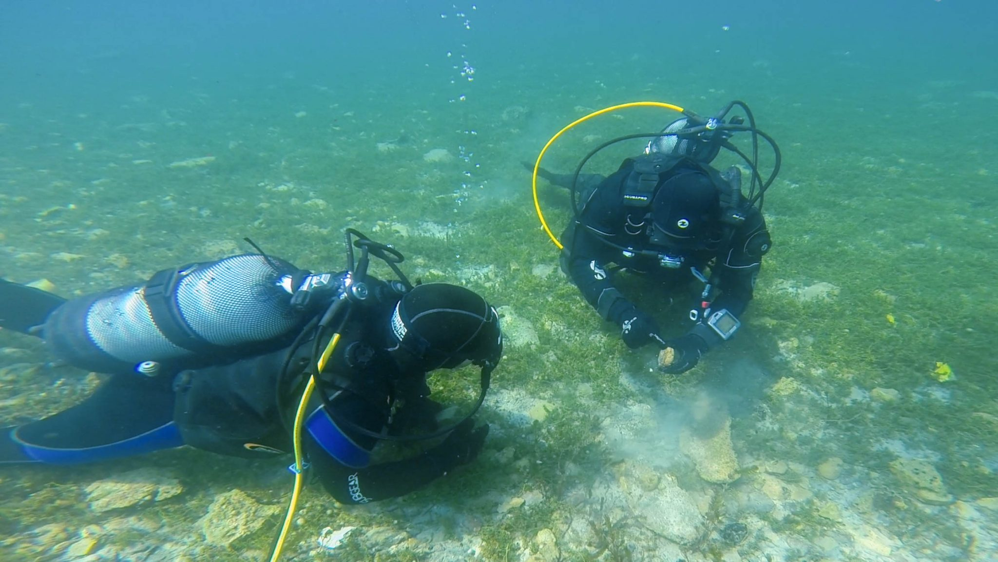Joey Getting An Archeology Lesson From Our Divemaster  while scuba diving in Macedonia