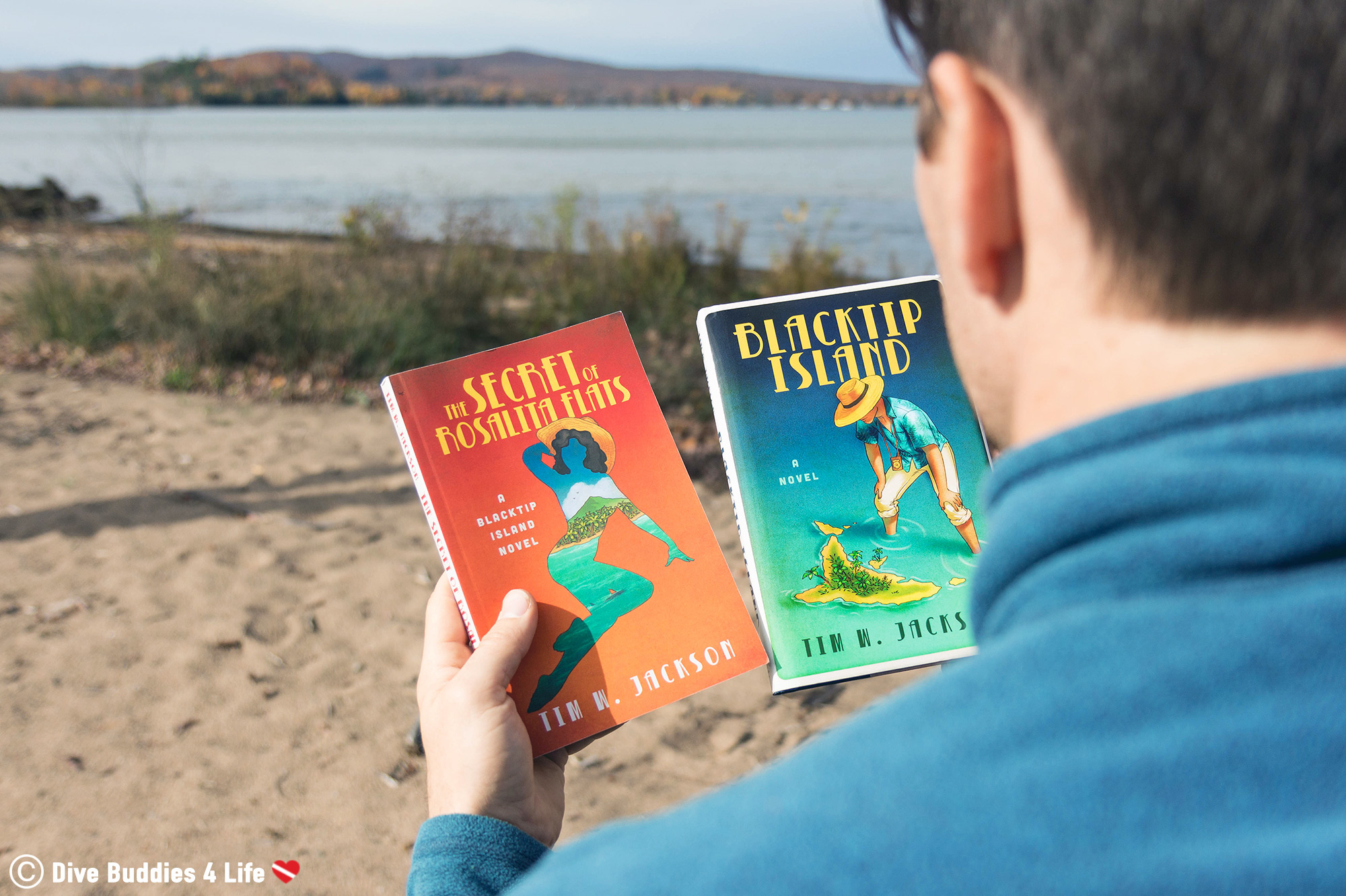 Joey Looking At Two Scuba Mystery Novels By Tim Jackson