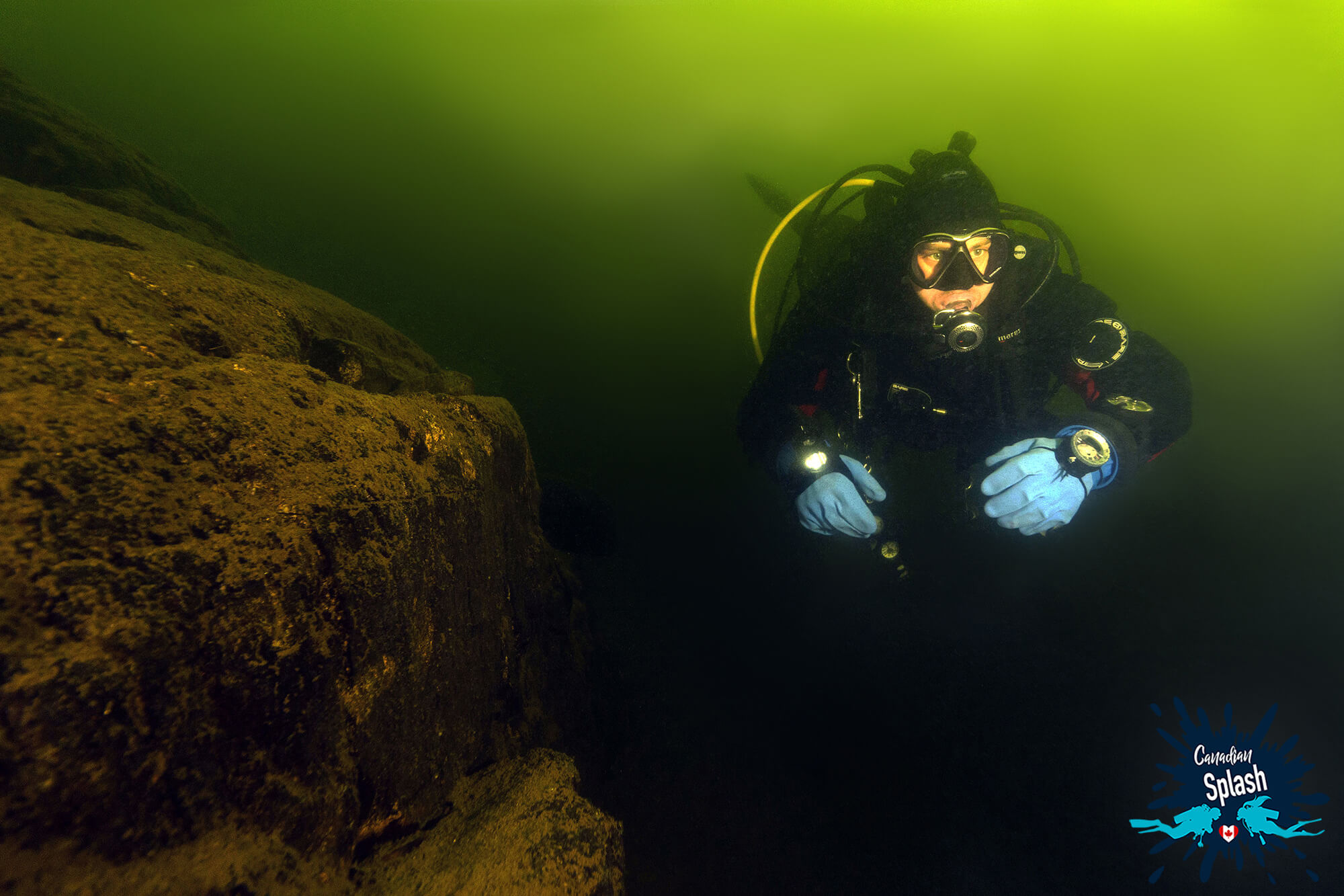 Joey Scuba Diving Along A Rocky Wall In Lake Temagami, Finlayson Point, Ontario Parks, Scuba Diving In Canada