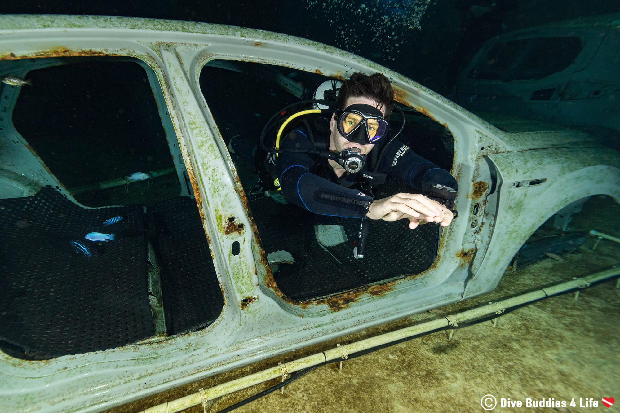 Joey Scuba Diving Through A Car At The Bottom Of The TODI Dive Pool In Belgium, Europe