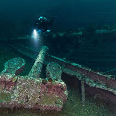 Joey Scuba Diving And Lighting Up A Large Anchor On The Deck Of The Saganaga Bell Island Shipwreck, Newfoundland, Scuba Diving Canada