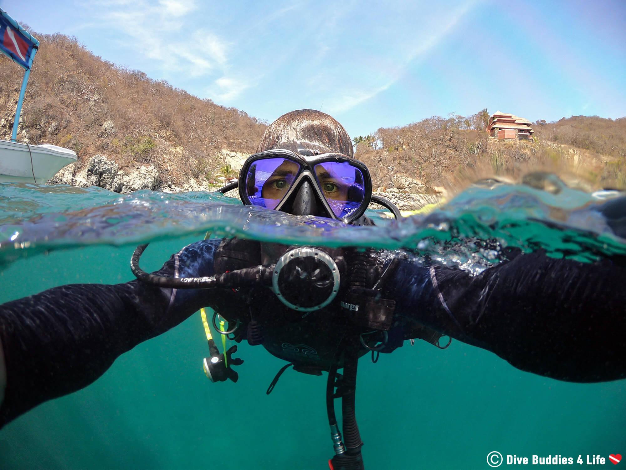 Joey Scuba Diving In Zihuatanjero, Split Surface Shot, Mexico