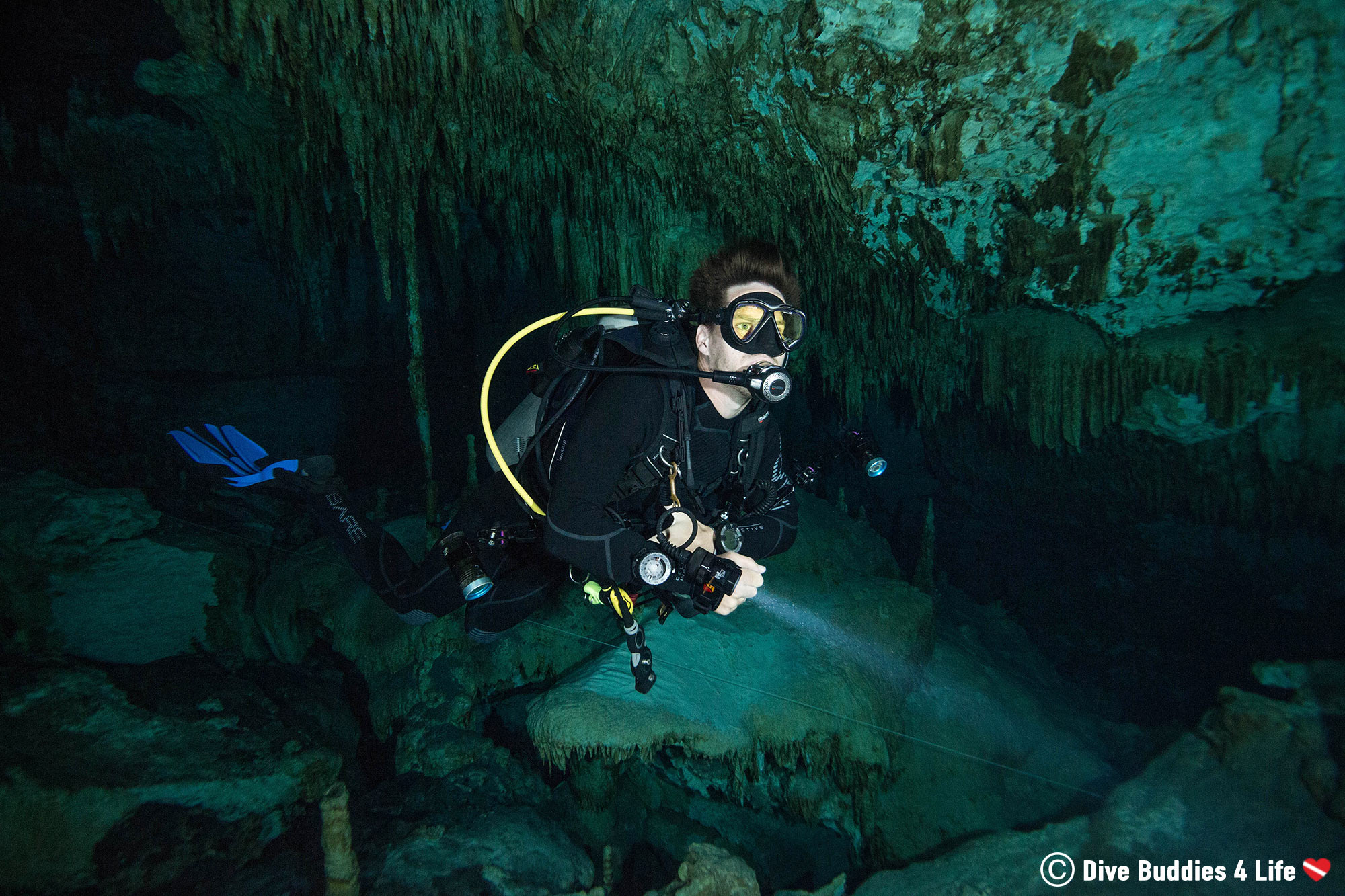 Joey Scuba Diving In The Dark Cavern's Of A Cenote In Mexico, Wide Angle Photograph