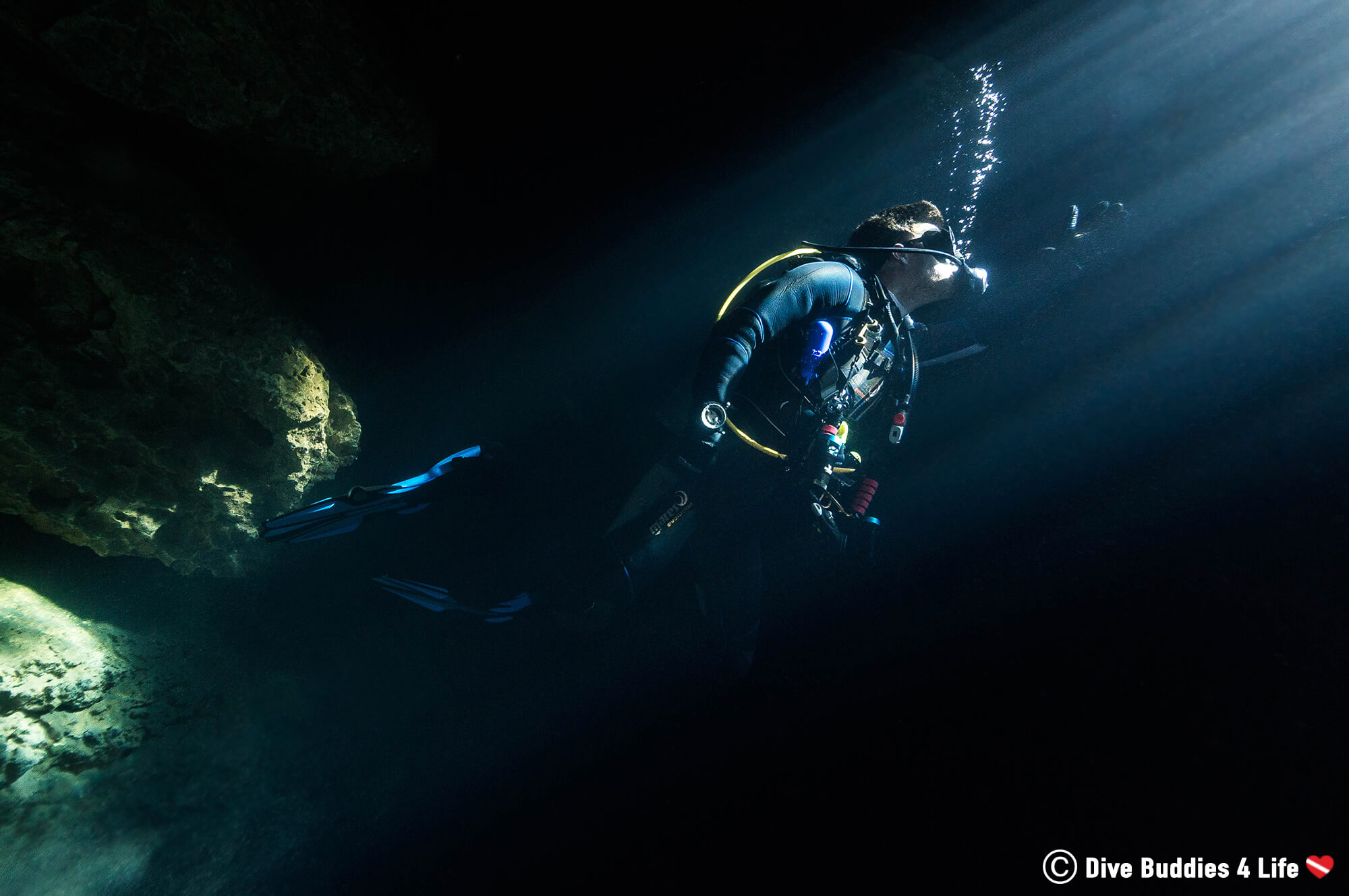 Joey Scuba Diving Into A Beam Of Light In The Devil's Den Spring, Florida, USA