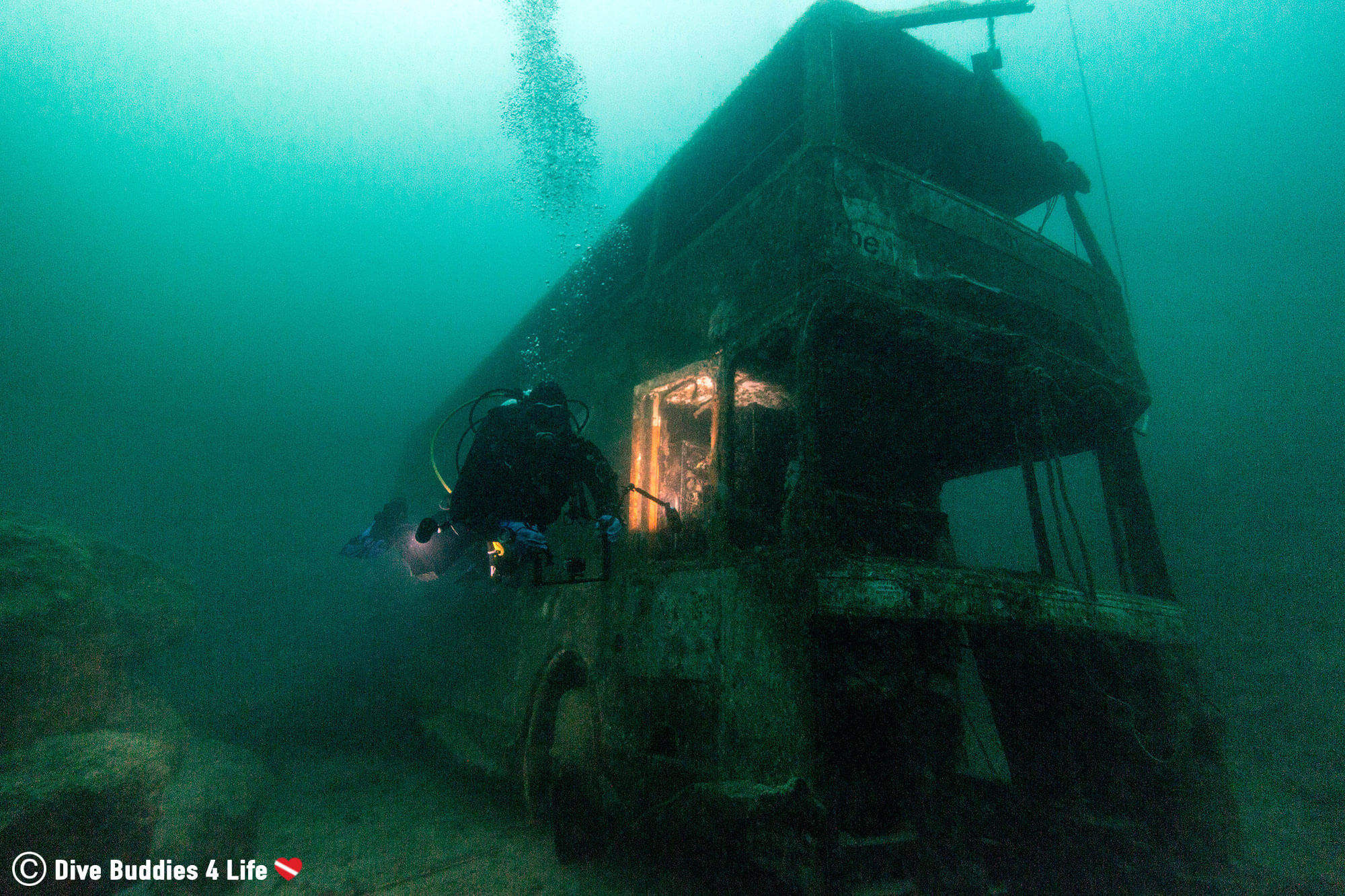 Joey Scuba Diving With A Double Decker Bus In A Freshwater Quarry In Chepstow, Wales, UK