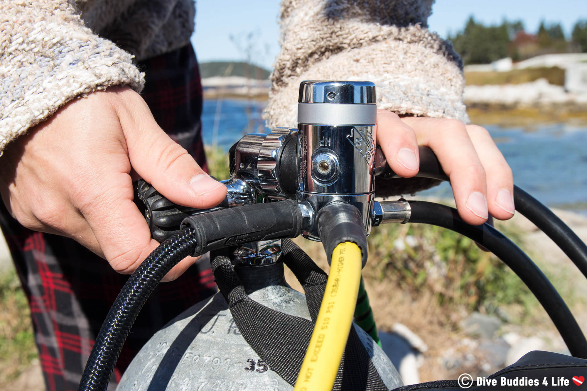 Joey Setting Up His Regulator And Tank For A Scuba Dive In New Brunswick, Canada
