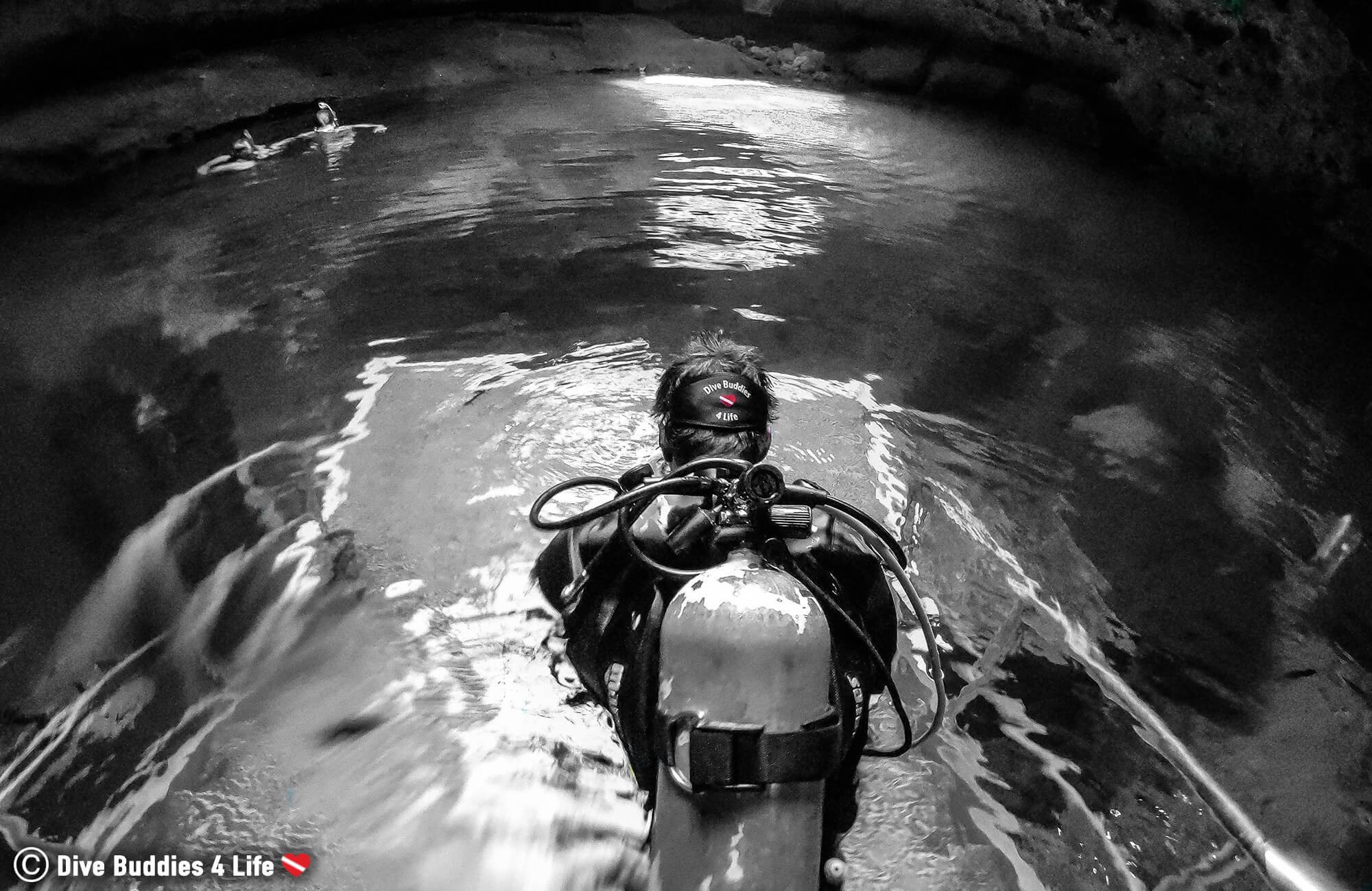 Joey Sitting At The Surface Of The Devil's Den Springs In His Diving Gear, Florida, USA