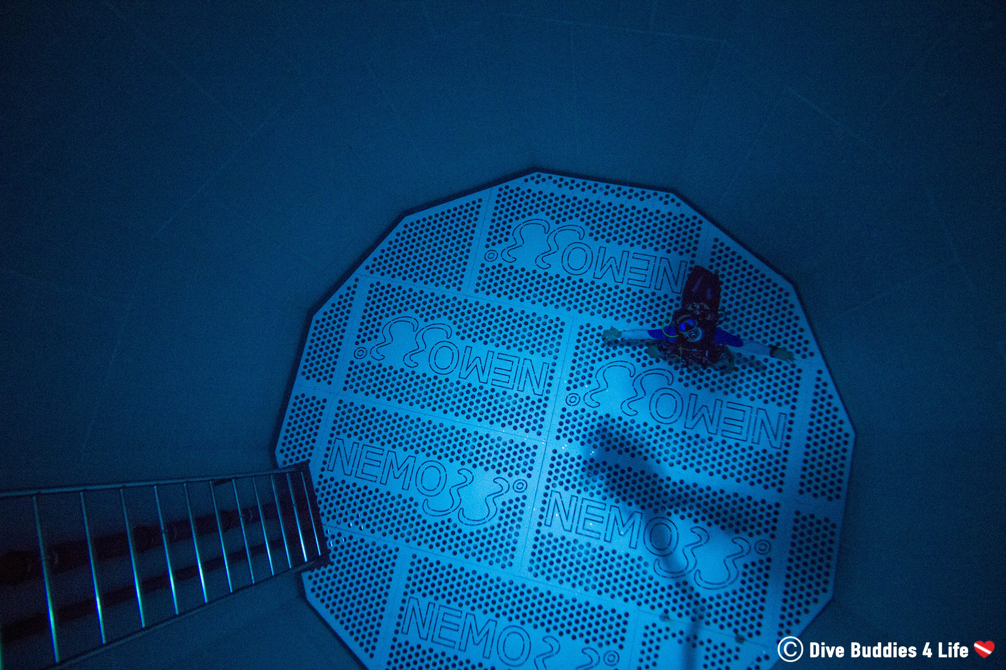 Joey Sitting On The Bottom Of The Nemo 33 Indoor Pool In Scuba Diving Gear Looking Into The Water, Belgium, Europe