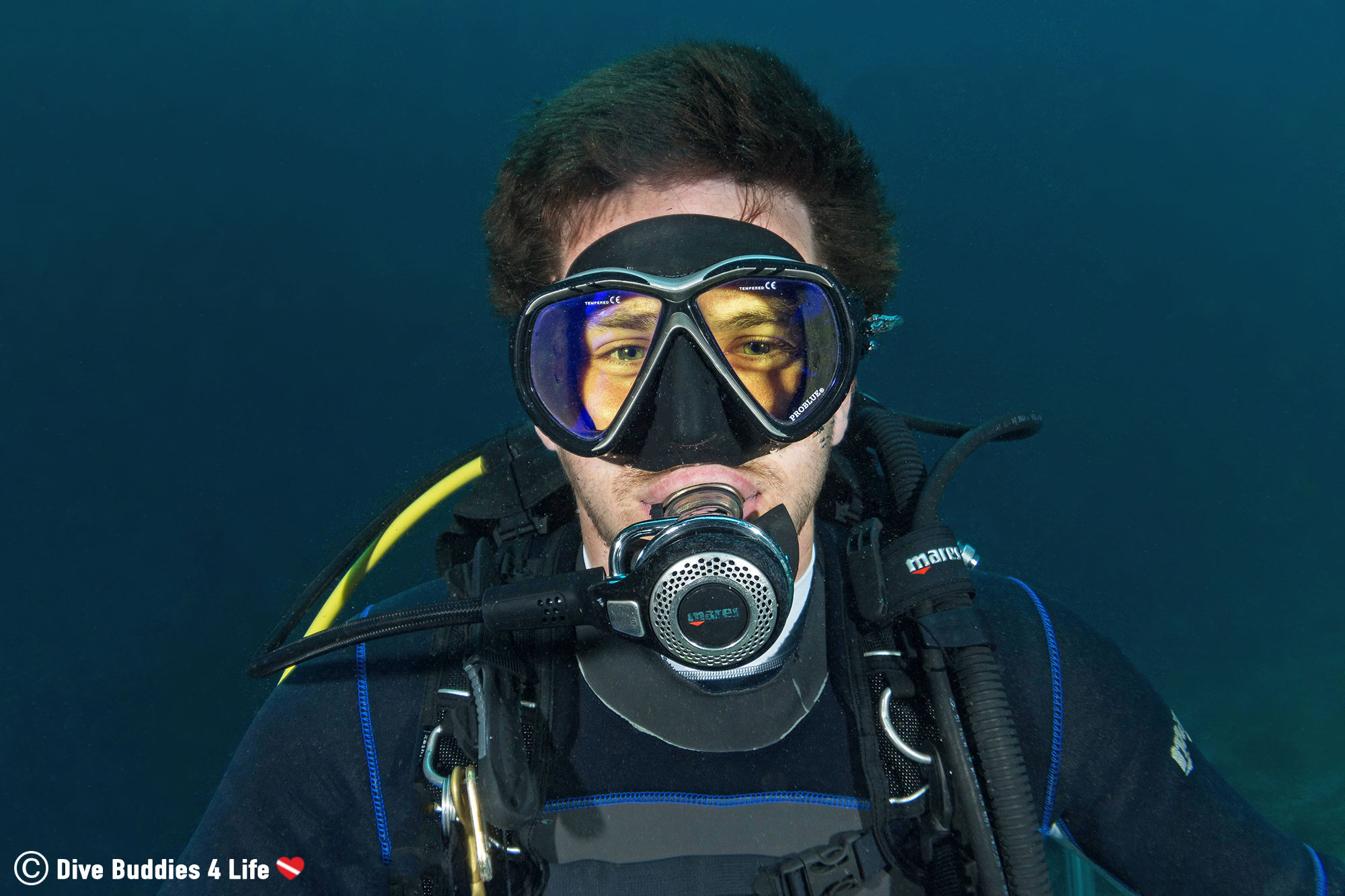 Joey Smiling Into His Regulator While Scuba Diving Because His Short Hair Isn't In His Face