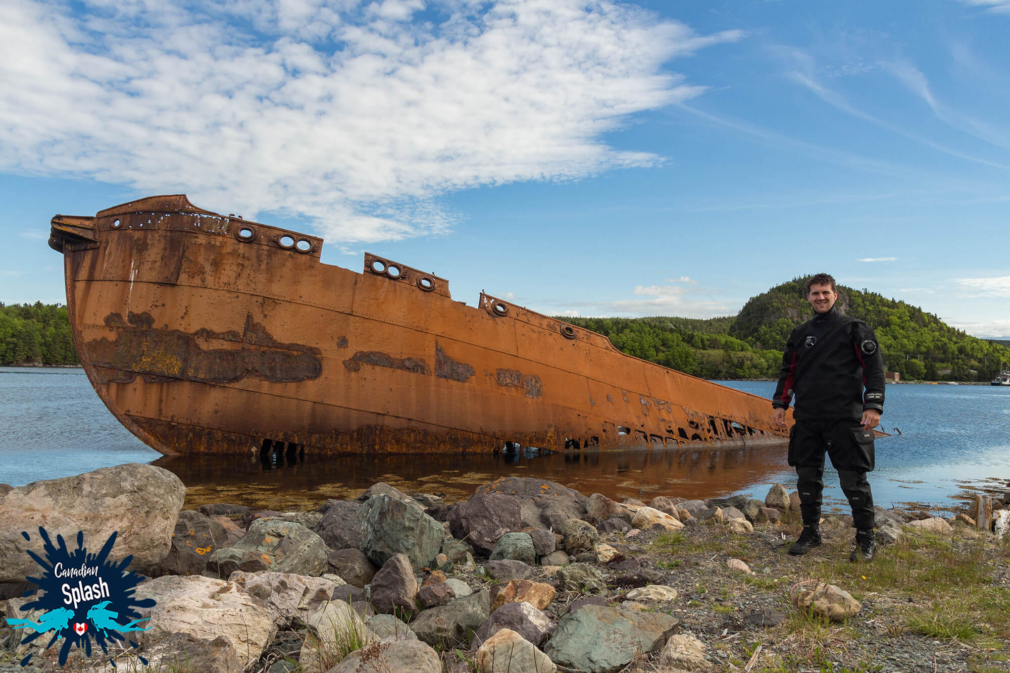 Joey Standing Beside A Newfoundland Whaling Shipwreck On The Coast Of Conception Bay, Canada Scuba Diving