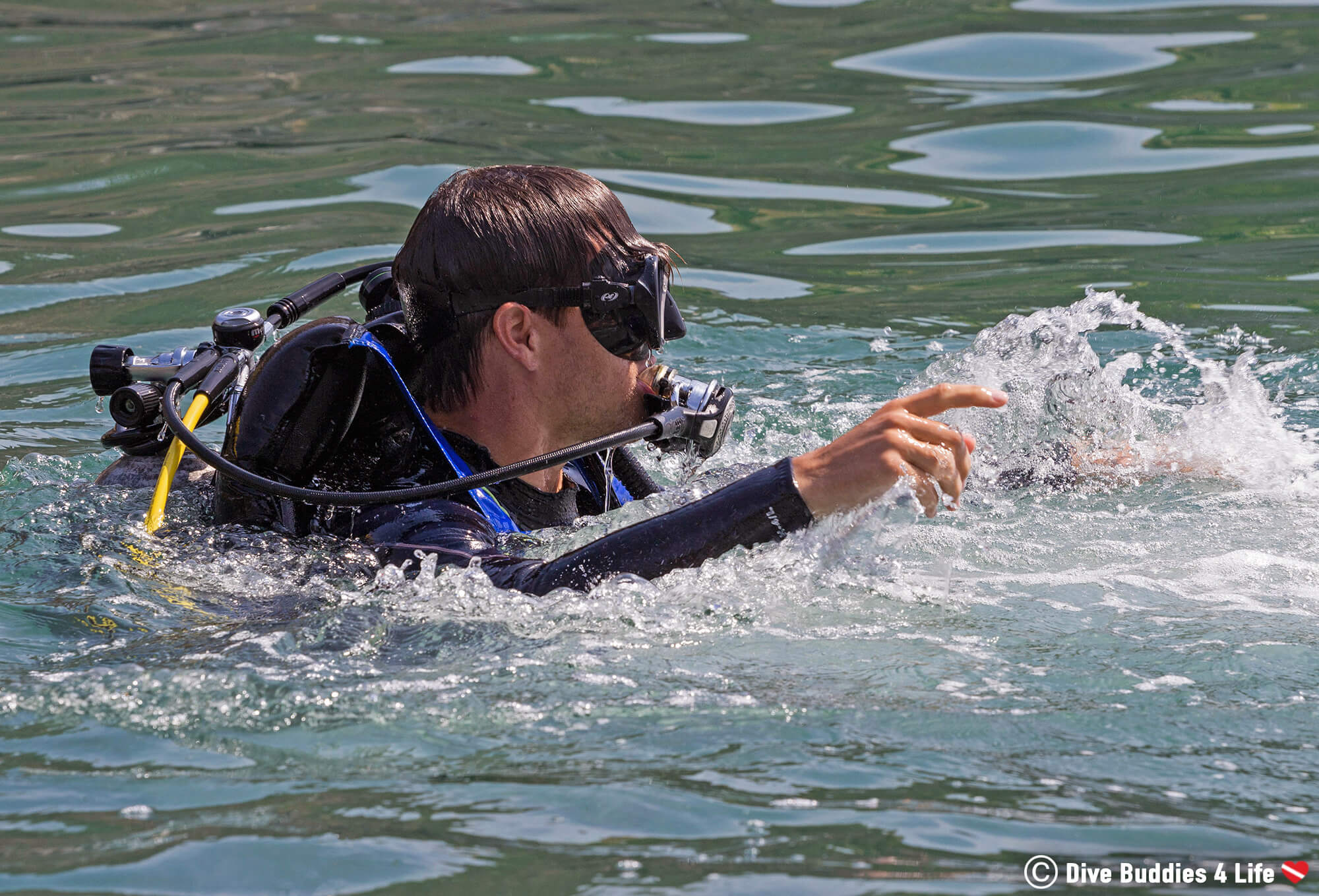 Joey Struggling To Stay At The Surface Of The Water In His Scuba Diving Equipment During The PADI Rescue Diver Course