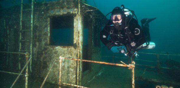 Joey Swimming Beside The Wheelhouse Of The Niagara II Shipwreck In Tobermory, Ontario, Scuba Diving Canada