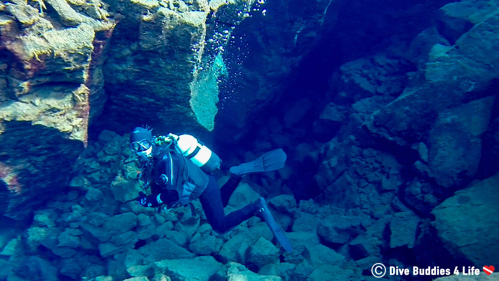 Joey Swimming With Scuba Gear Deep In The Silfra Crack In Iceland, Europe