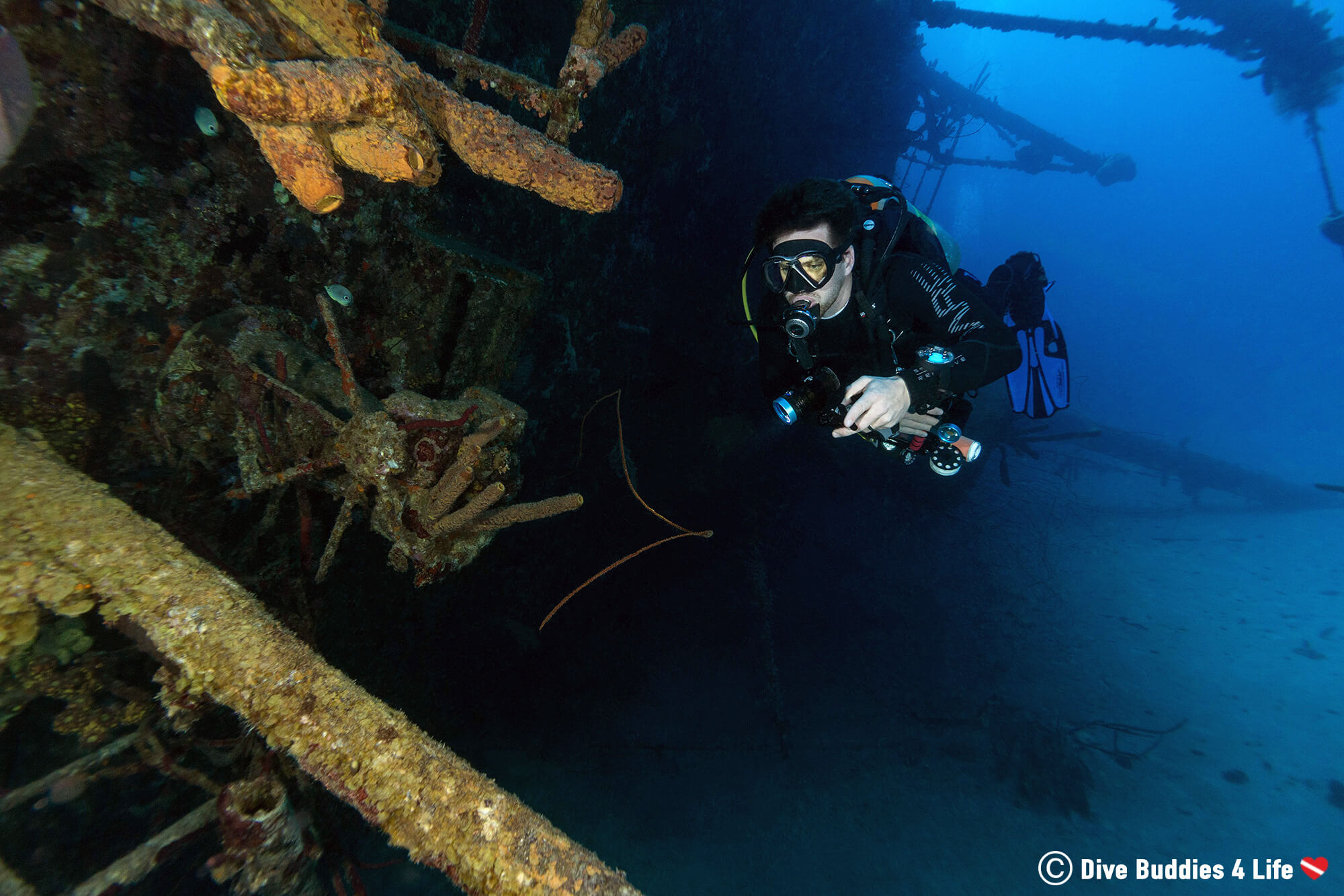 Joey Using His Flashlight And Diving The Hilma Hooker Shipwreck On The South Of Bonaire, Dutch Caribbean
