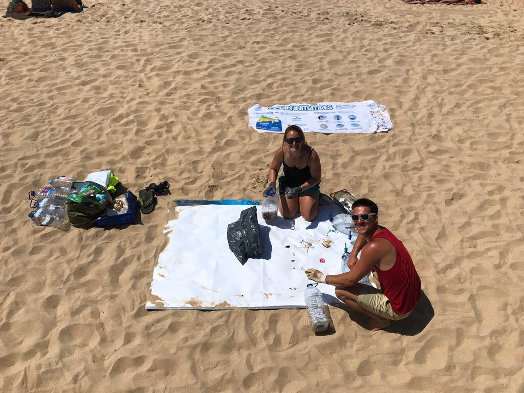Joey And Ali Sorting Through Trash At The Beach Cleanup