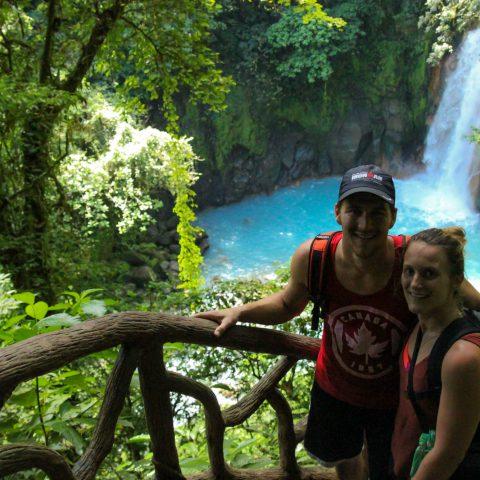 Joey and Ali with the Rio Celeste River in Costa Rica