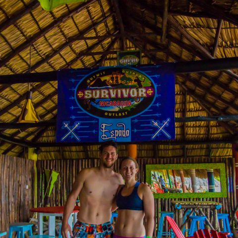 Joey and Ali with the Survivor Banner