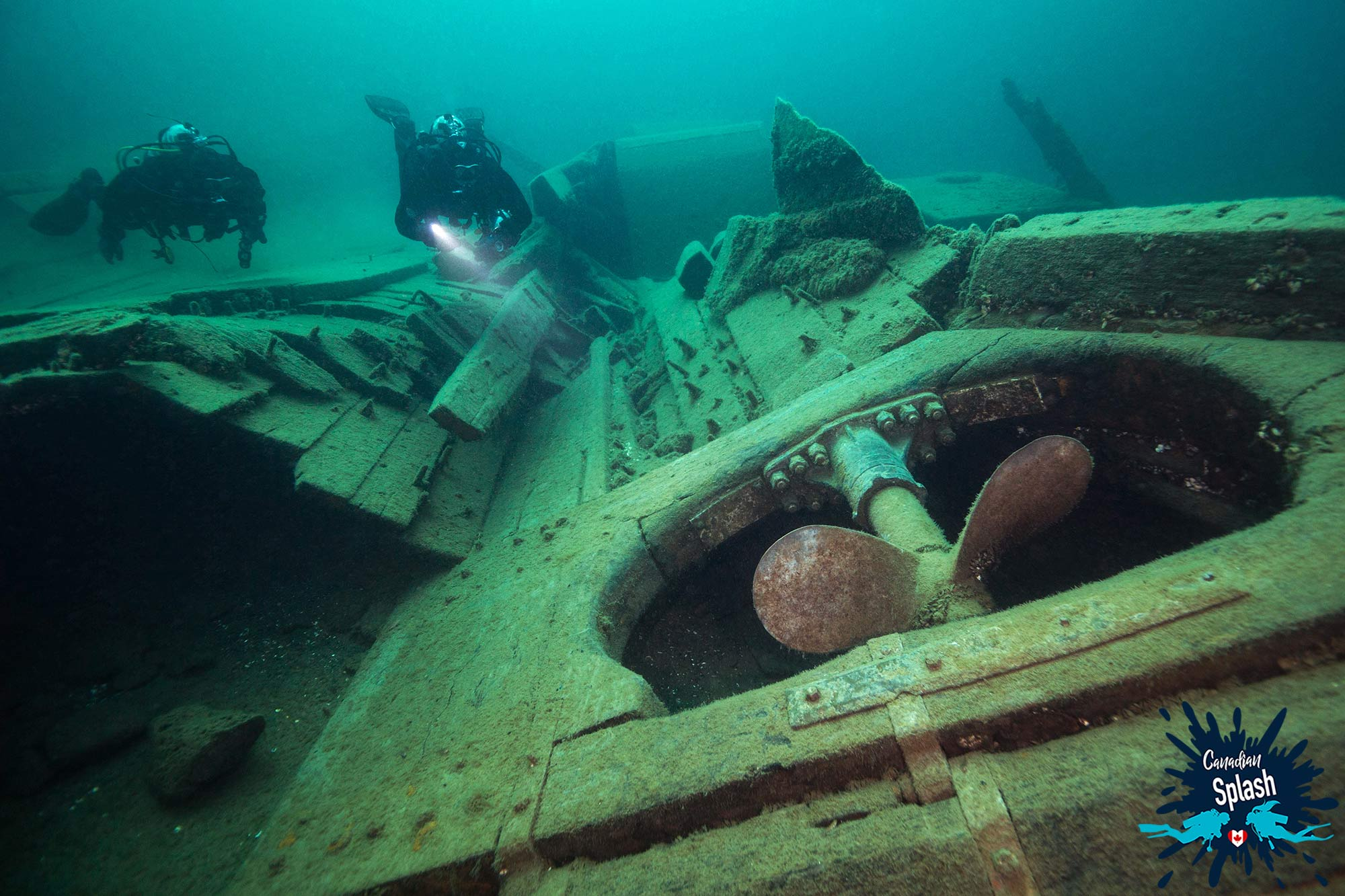 Joey And Dad Exploring The Propeller Of The Caroline Rose Shipwreck In Tobermory, Ontario, Scuba Diving Canada