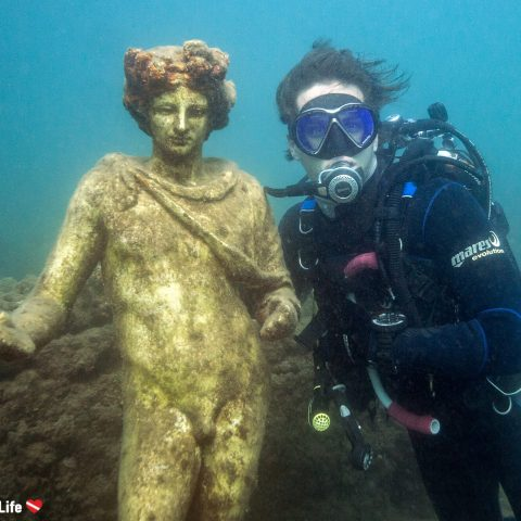 Joey And An Old Roman Statue Scuba Diving Together At The Baiae Submerged Village In Naples, Italy, Europe