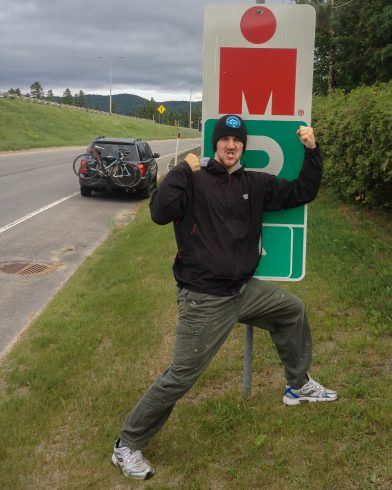 Joey On The Side Of The Highway With The Iron Sign