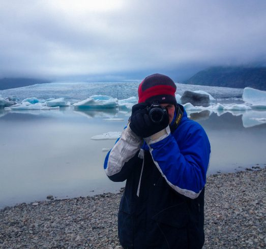 Joey taking a Picture at the Glacier Lagoon in Iceland