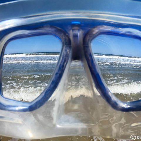 Looking Through A Scuba Mask At The Waves In Daytona, Florida, USA