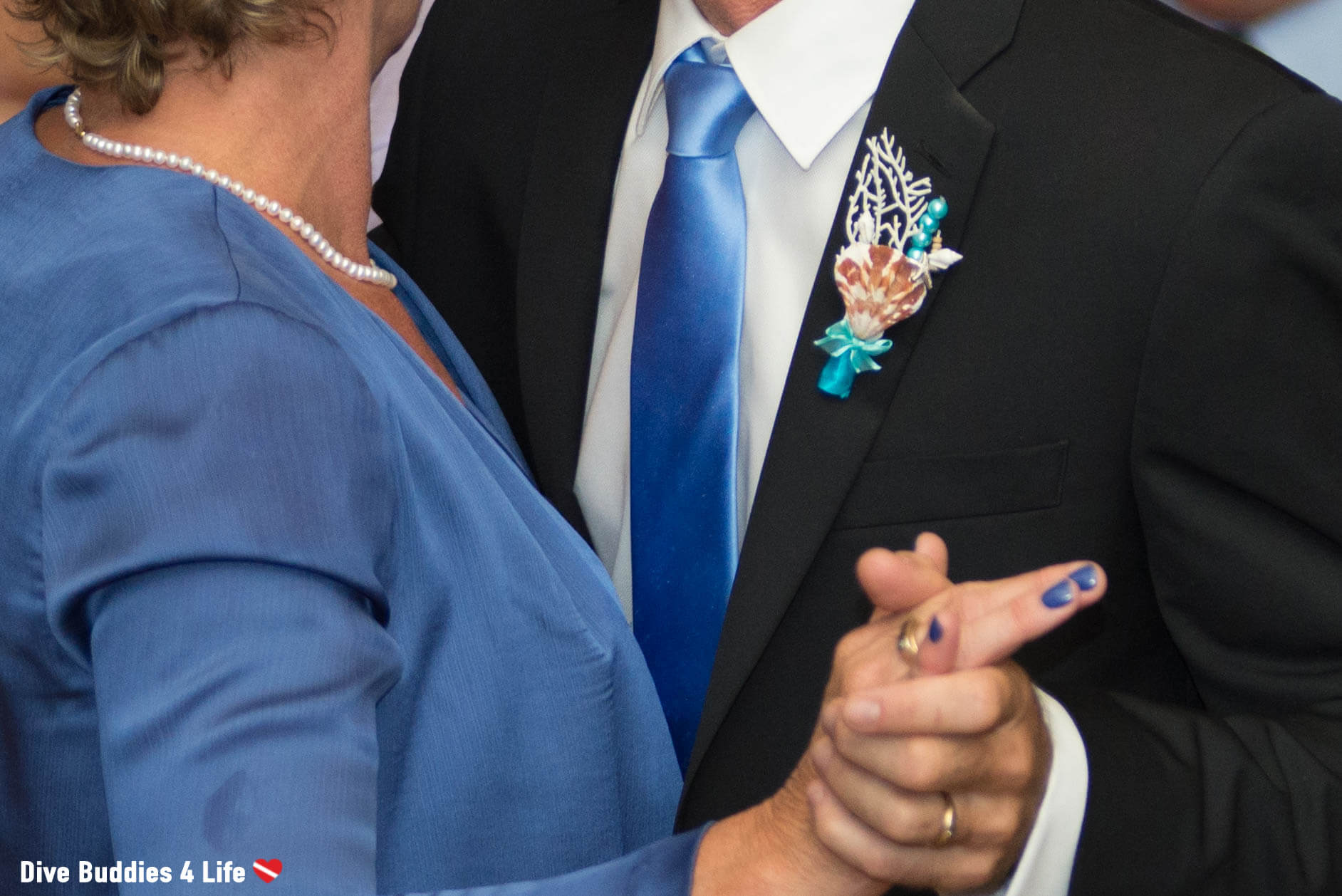 Marine Themed Boutonniere For The Men At A Scuba Diving Wedding