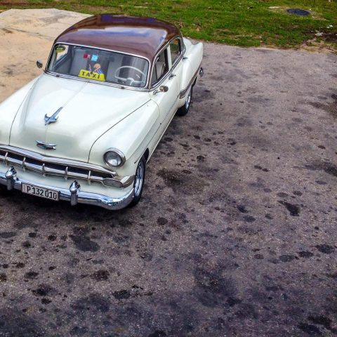 An Old White Cuban Car
