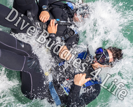 Pair Of Divers Back Rolling Into The Water Scuba Shop