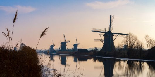 Pink Sky And Kinderdijk Windmills in the Netherlands, Europe