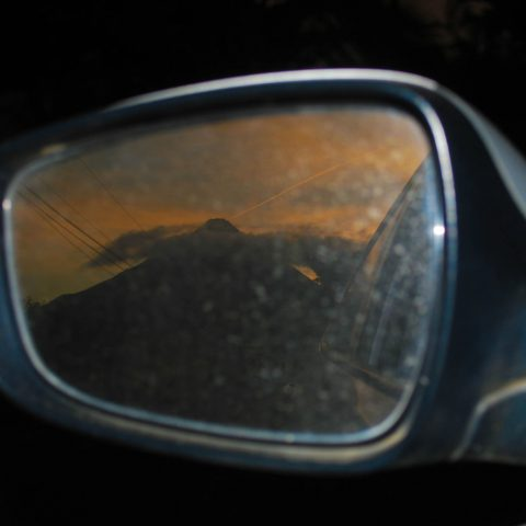 The Rental Car's Rear View Mirror with the Arenal Volcano in Costa Rica