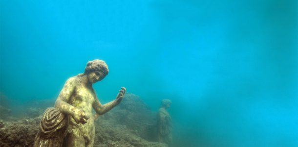 Roman Statues Under The Mediterranean Sea In The Gulf Of Naples At The Archeological Dive Site Baiae In Italy, Europe No Watermark