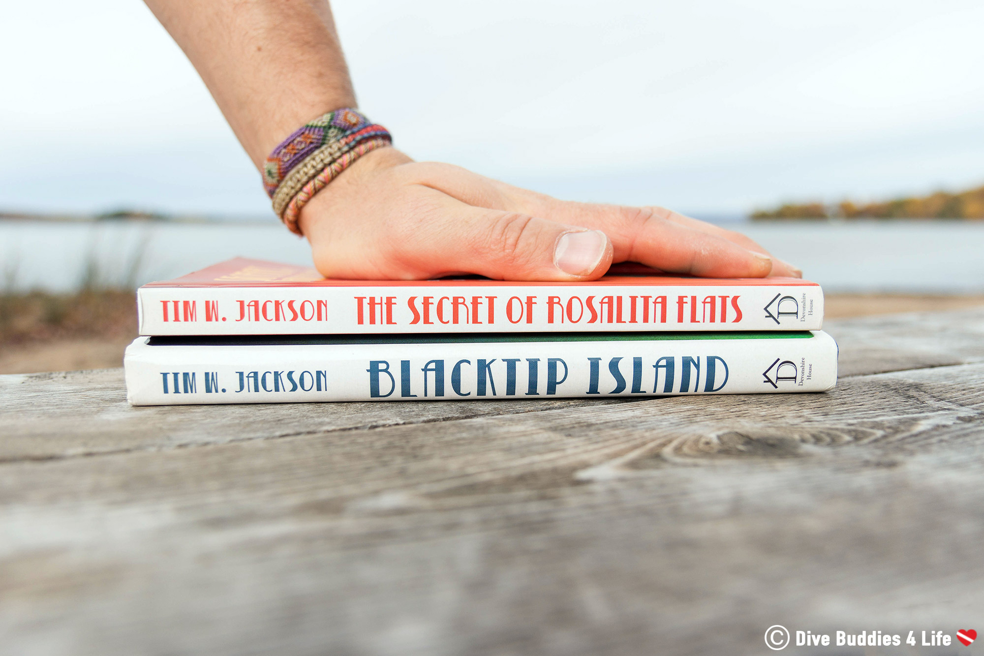 Rosalita Flats And Blacktip Scuba Diving Novels By Tim W. Jackson With Joey's Hand Holding Them