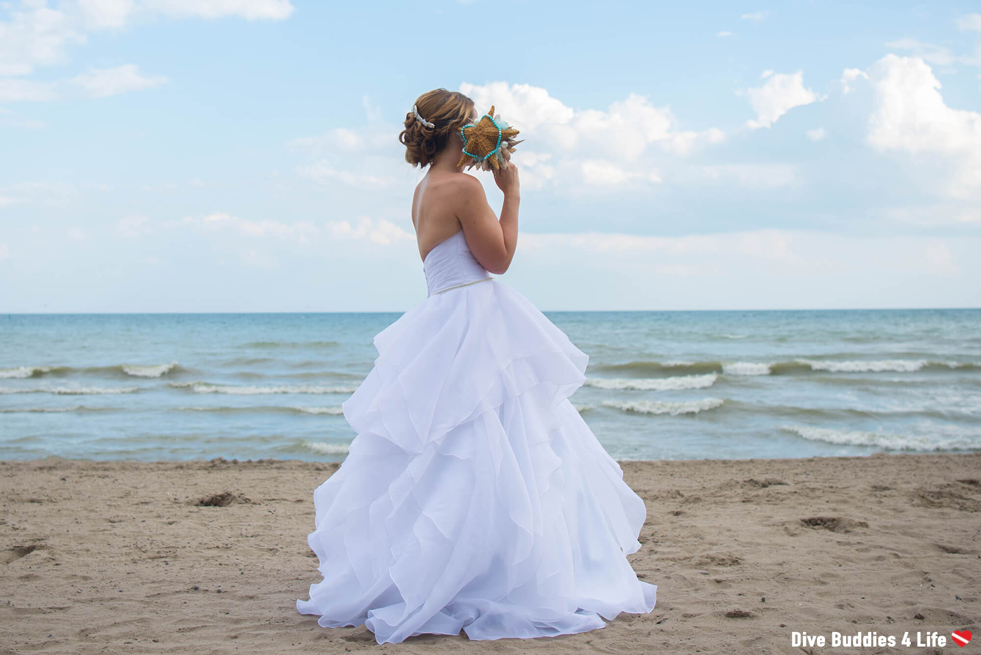 Scuba Ali On The Beach With Her Wedding Bouquet And Waves In The Background