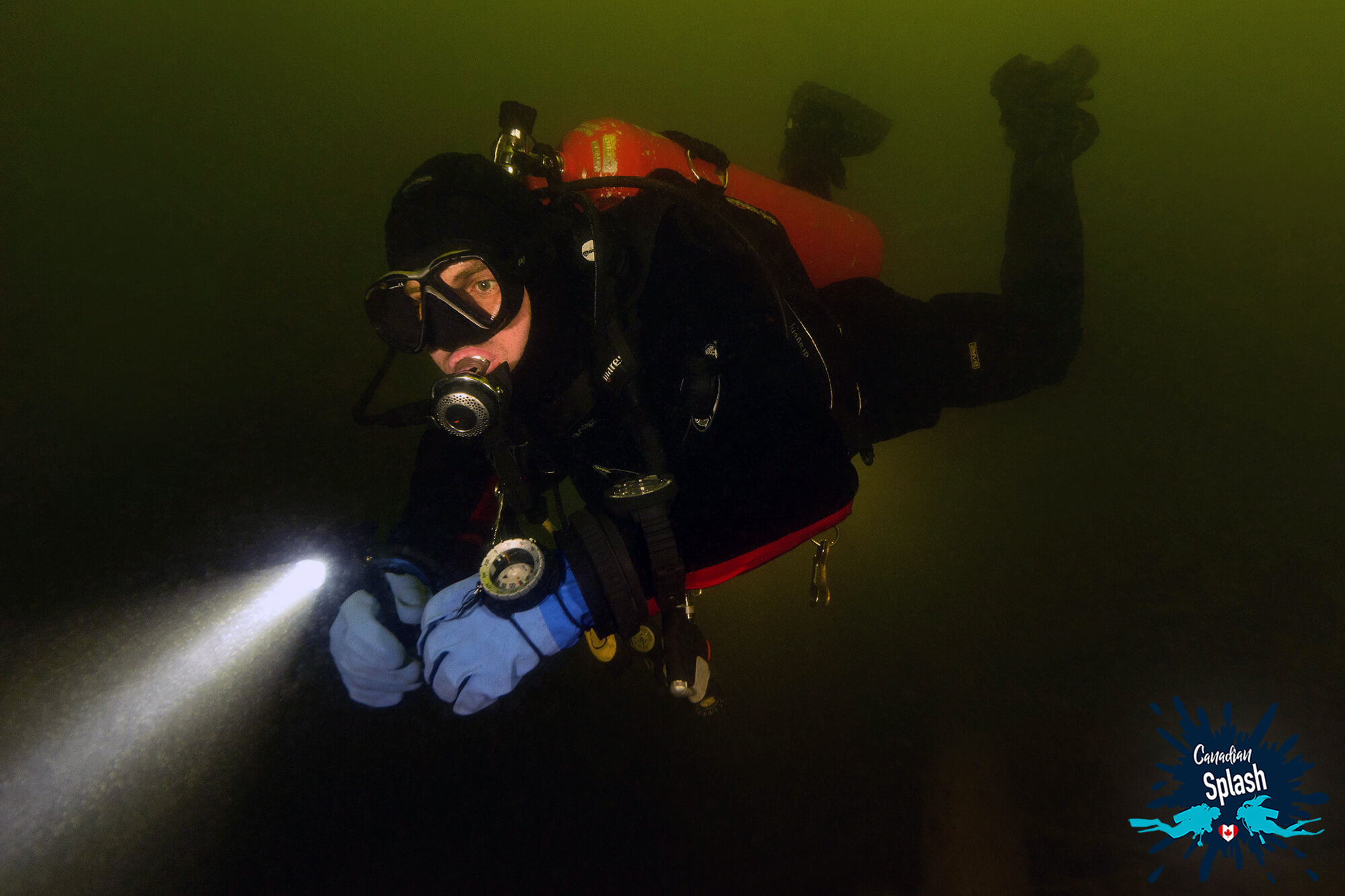 Scuba Diver Joey Exploring The Depths Of Lake Temagami With His Dive Light, Finlayson Provincial Park, Temagami Ontario, Scuba Diving Canada