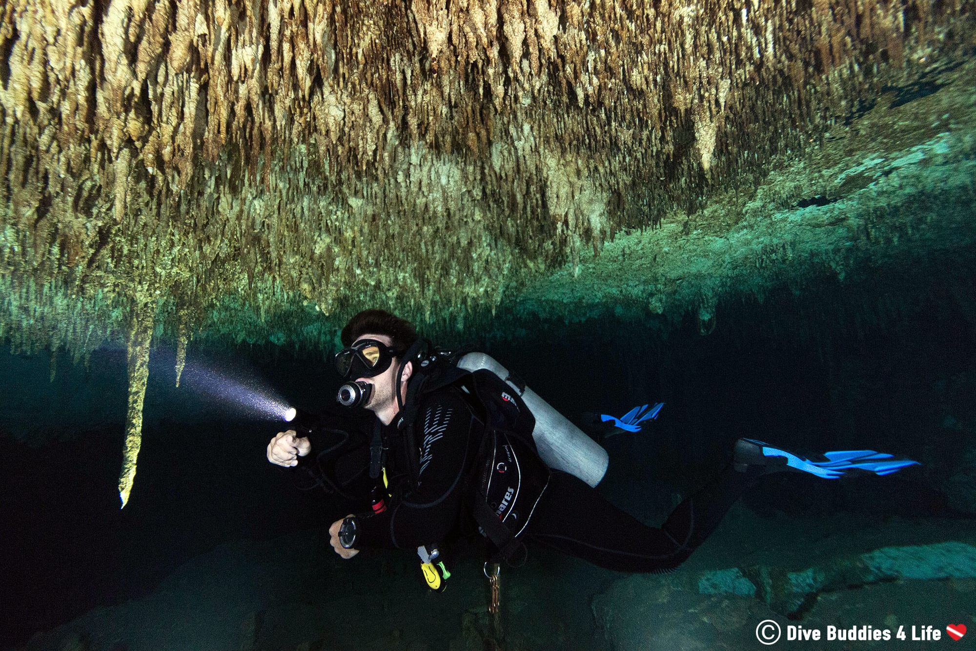 Scuba Diver Joey Flashing His Light On The Roof Of A Cenote Cave In Tulum, Mexico