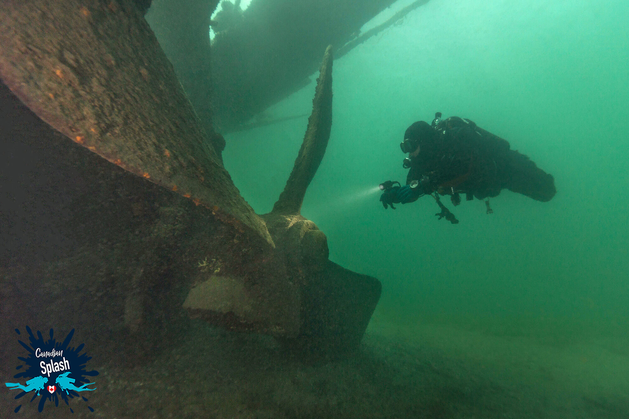 Scuba Diver Joey And The Large Propeller Of The Conestoga Shipwreck In Cardinal, Ontario For Canadian Splash