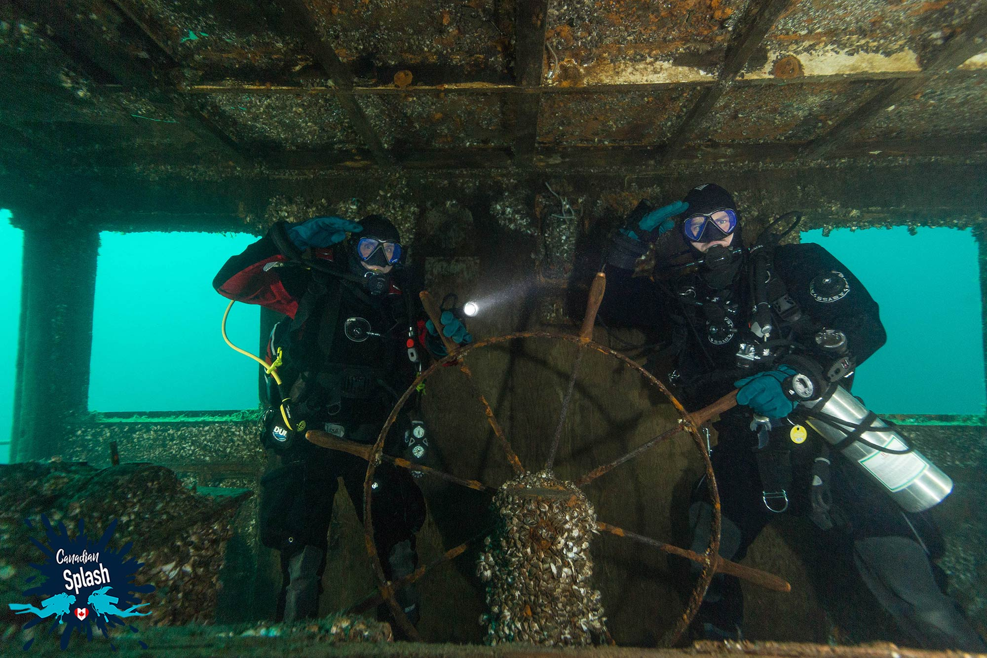 Scuba Divers Joey And Dad In The Wheelhouse Of The Niagara II Shipwreck In Tobermory, Ontario, Canada Scuba Diving