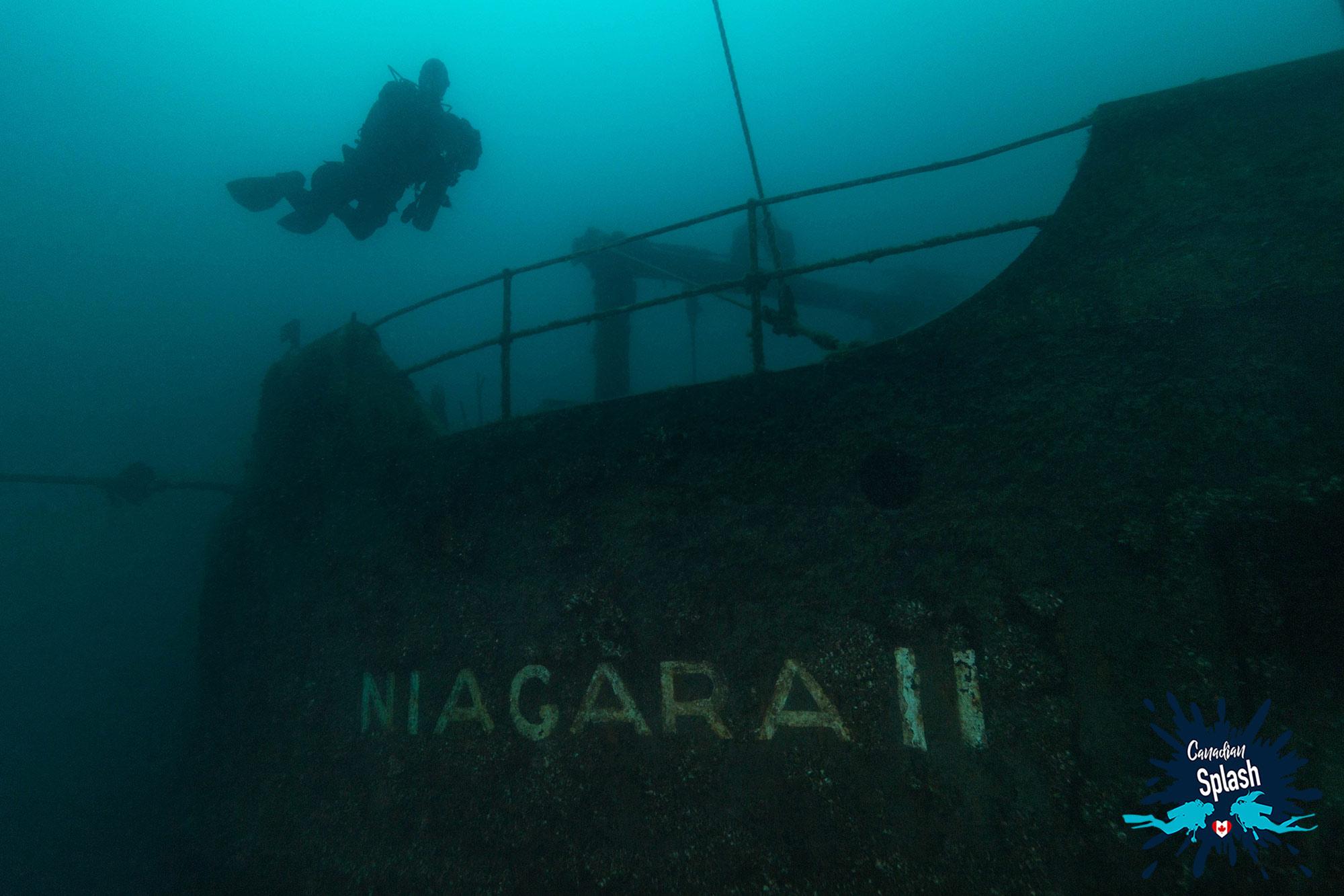Scuba Divers Silhouette Diving Tobermory's Niagara II, Ontario, Canada Diving
