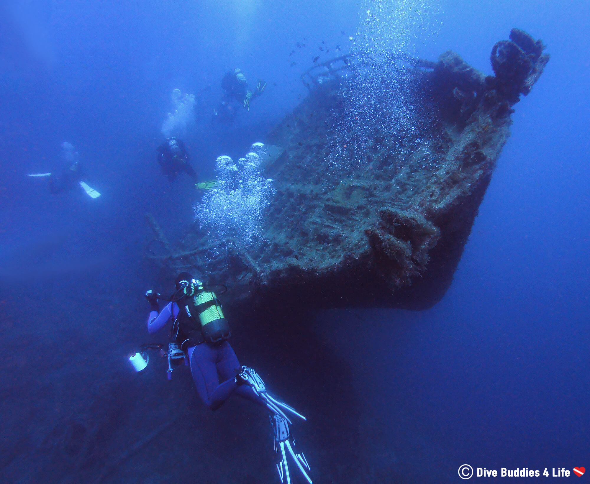 Scuba Divers And A Shipwreck At The Bottom Of Puerto Del Carmen On Lanzarote, Spain's Canary Islands