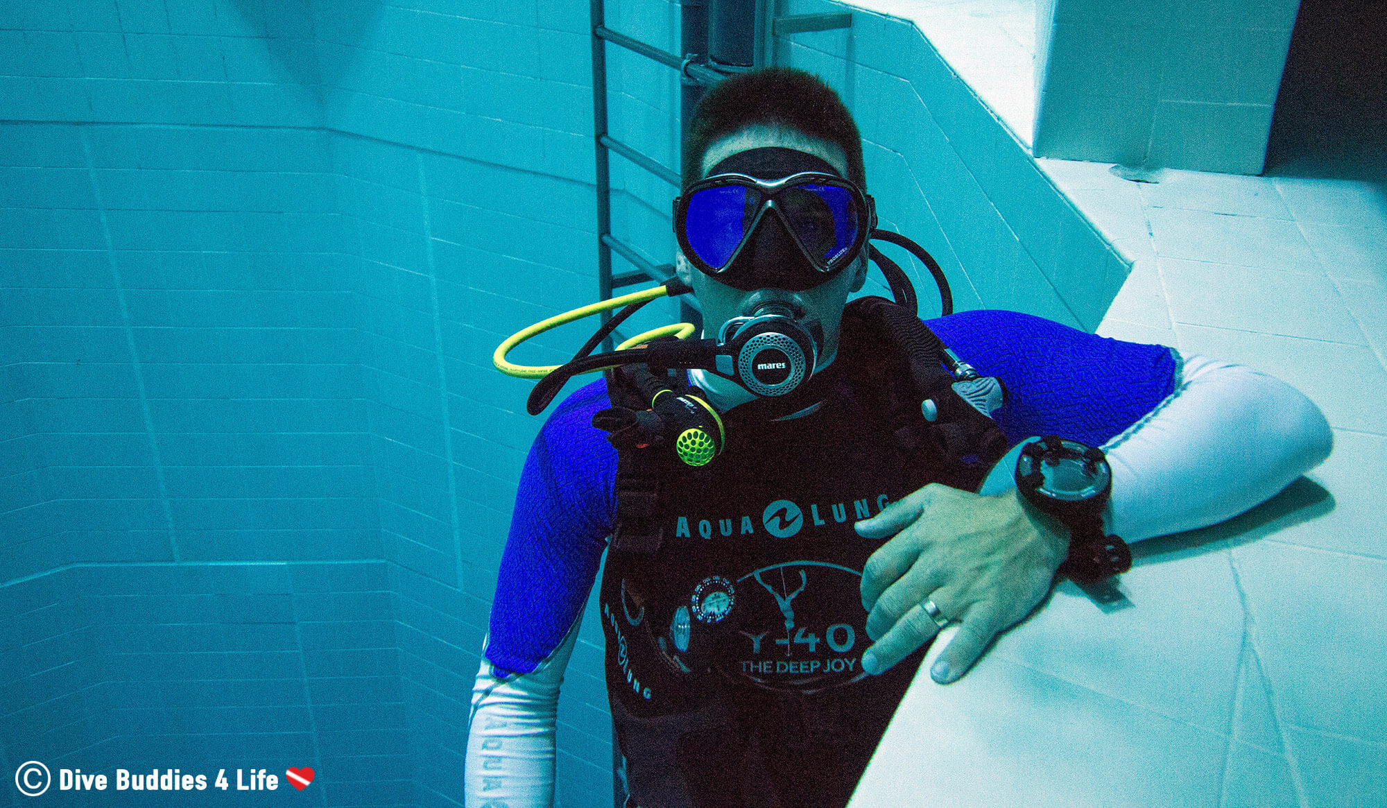 Scuba Diving Joey Hanging Out On The Ledge Of The Nemo 33 Second Deepest Pool In The World, Belgium, Europe