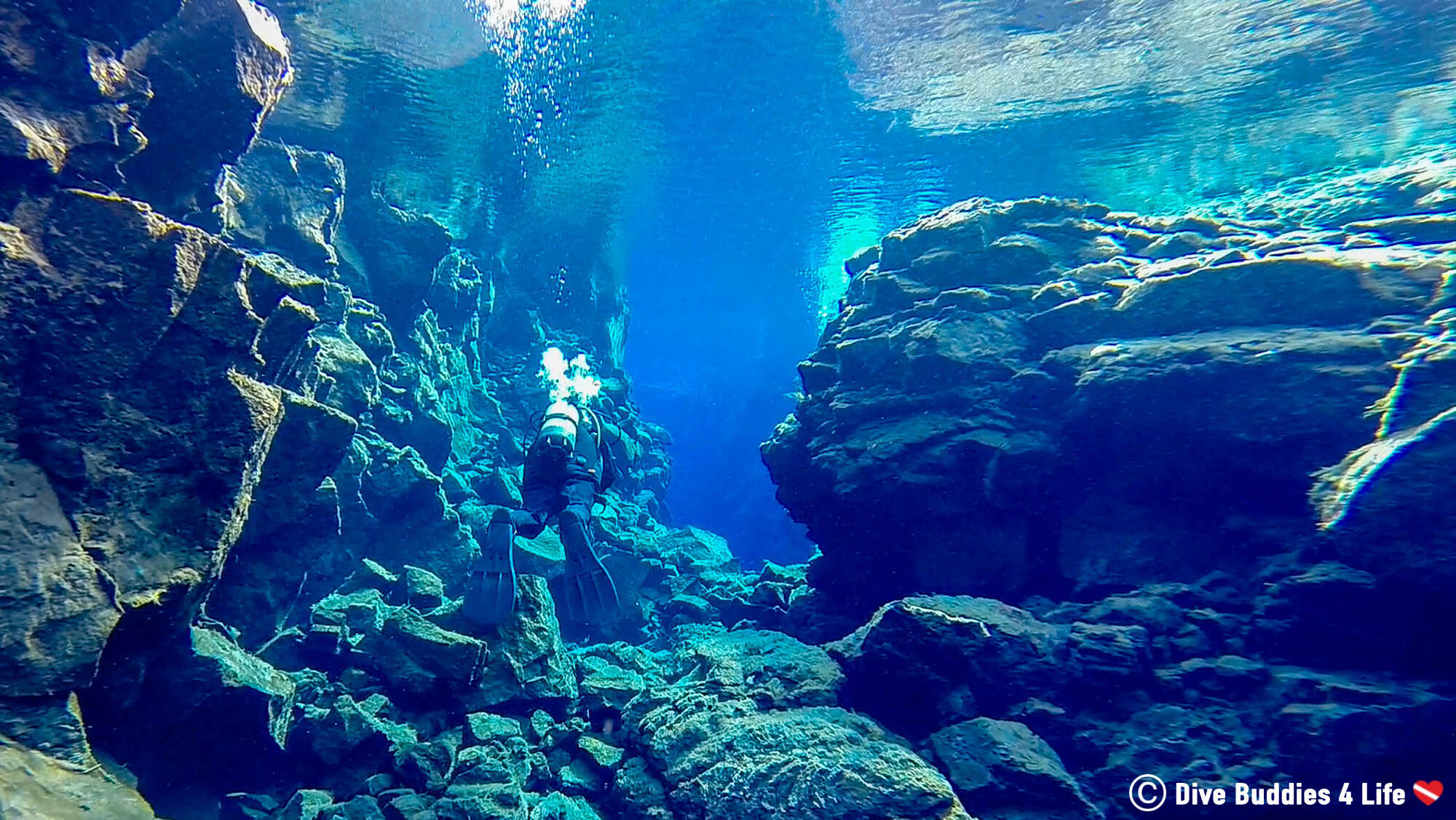 Scuba Diving In The Lava Rock Formations Of The Silfra Crack
