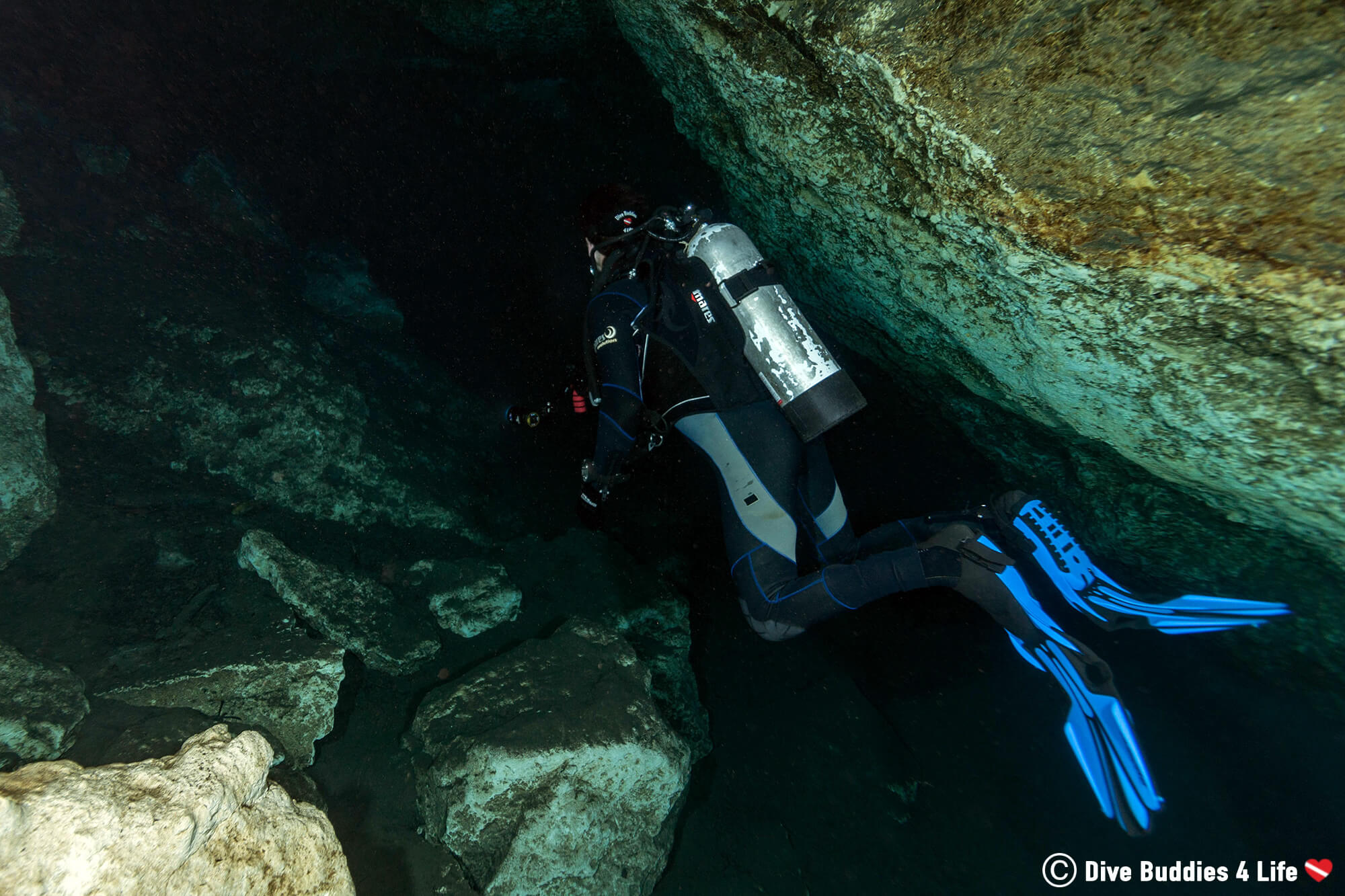 Scuba Joey Looking Into The Blue Grotto Swim Through Cave Deep In The Depths Of The Sinkhole, Florida, USA