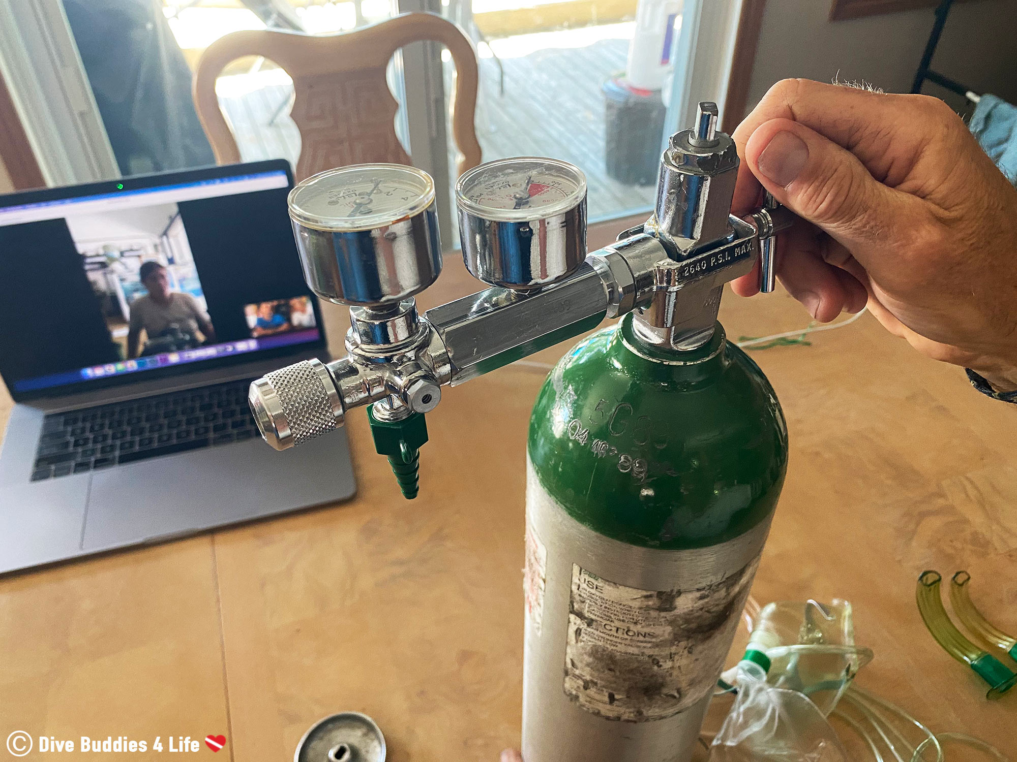 Securing The Valve On The Oxygen Cylinder For The Remote PADI Emergency Oxygen Provider Course